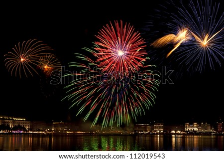 Colorful firework over the Binnenalster lake at Hamburg