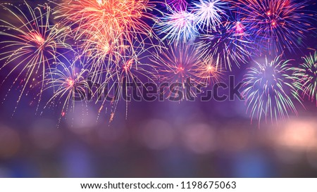 Colorful firework with bokeh background with copy space for New Year celebration, Abstract holiday background stock photo