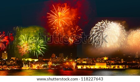 Colorful fireworks all over the Istanbul sky. View of Besiktas, Dolmabahce Palace - stock photo
