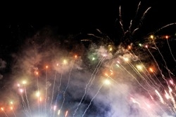 Colorful fireworks and smoke and black sky