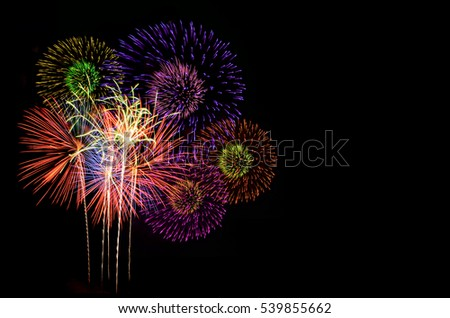 Colorful fireworks celebration and the city night light background. #539855662