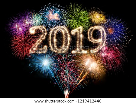 colorful fireworks display and bright sparkler pyrotechnic number 2019 happy new year sylvester concept on black blue background #1219412440