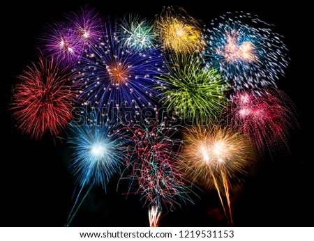colorful fireworks display and bright sparkler pyrotechnic number 2019 happy new year sylvester concept on black blue background #1219531153