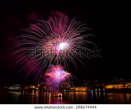 Colorful fireworks explode in Malta in dark sky,Malta fireworks festival, 4 July, Independence day, fireworks explode, New Year, fireworks in Valletta isolated in dark background with place for text