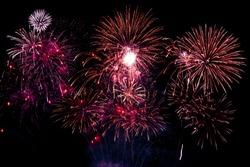 Colorful fireworks festivals on black background.
