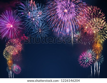 colorful fireworks on the black sky background with free space for text. Celebration and anniversary concept #1226146204