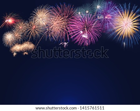 colorful fireworks on the black sky background with free space for text. Celebration and anniversary concept #1415761511
