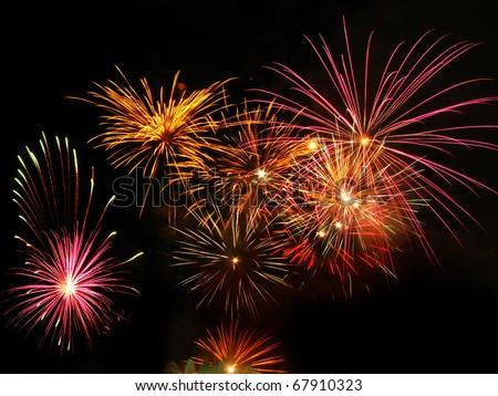 Colorful fireworks over dark sky, displayed during a celebration event