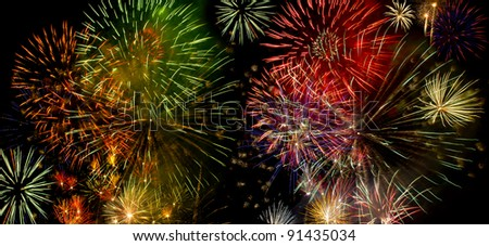 Colorful fireworks over dark sky during a celebration