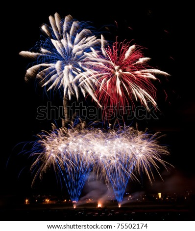 Colorful fireworks with blue, red and white streaks