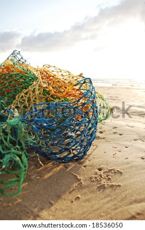 colorful fish net at the beach - stock photo