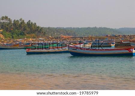 colorful fisherman boats in India (Kerala, Kovlam) - stock photo