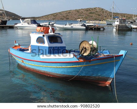 Colorful fishing boat in the harbor of Lipsi island, Greece.