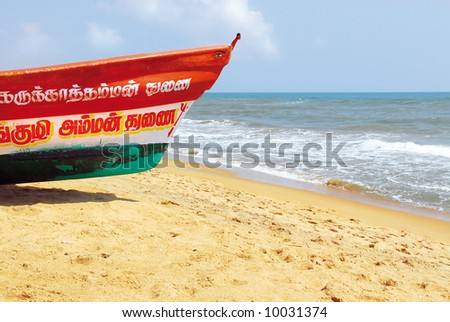 colorful fishing boat on beach of mahabalipuram, india