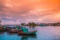 Colorful fishing boats in a harbour. Phu Quoc island, Vietnam.