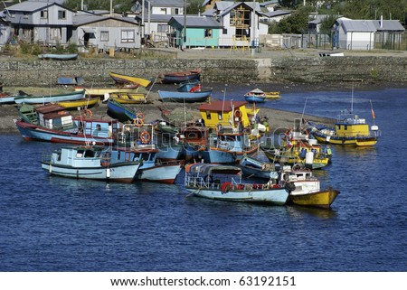 Colorful Fishing boats in harbor at Puerto Montt, Chile.