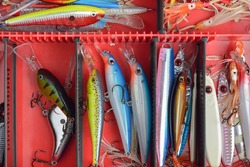 Colorful Fishing Lures on plastic box  desk different fishing baits The fishing equipment.