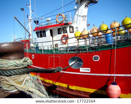 Colorful fishing trawler ready to leave the harbor