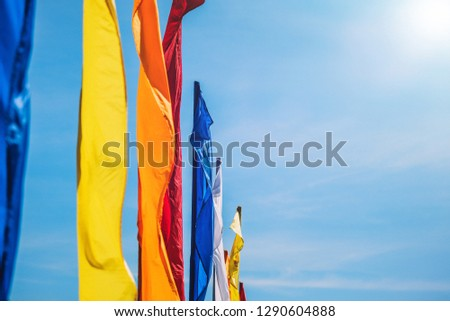 Colorful flags against blue sky #1290604888