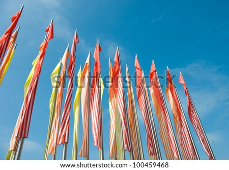 Colorful flags against the blue sky