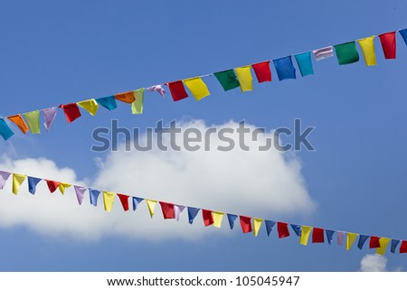 Colorful flags in the air, useful as background