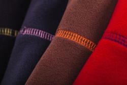 Colorful fleece clothes with seams, close up photo