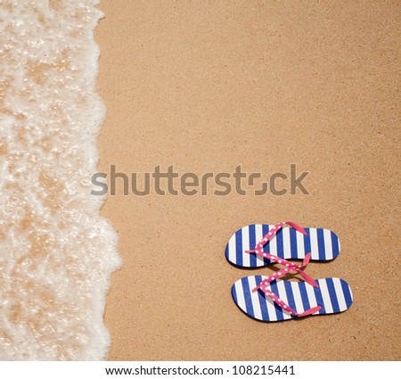 Colorful flipflop pair on sea beach top view