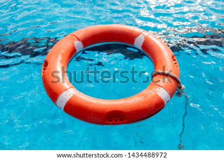 Colorful floats on a pool of crystal clear water #1434488972