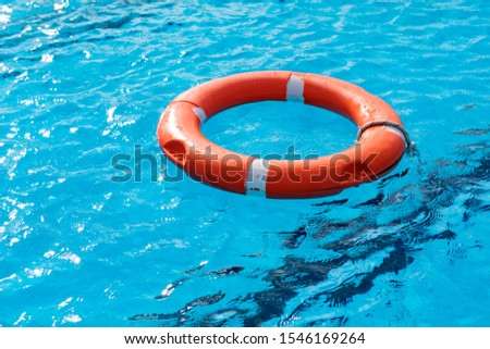 Colorful floats on a pool of crystal clear water #1546169264