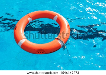 Colorful floats on a pool of crystal clear water #1546169273