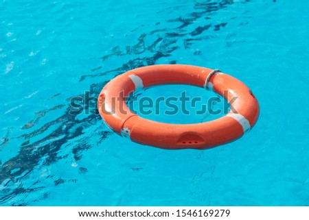 Colorful floats on a pool of crystal clear water #1546169279