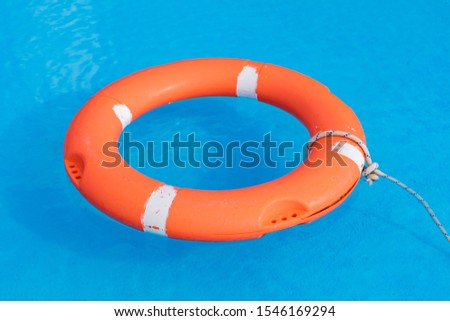 Colorful floats on a pool of crystal clear water #1546169294