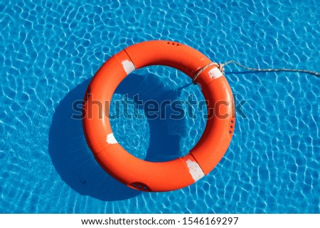 Colorful floats on a pool of crystal clear water #1546169297