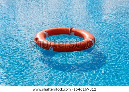 Colorful floats on a pool of crystal clear water #1546169312