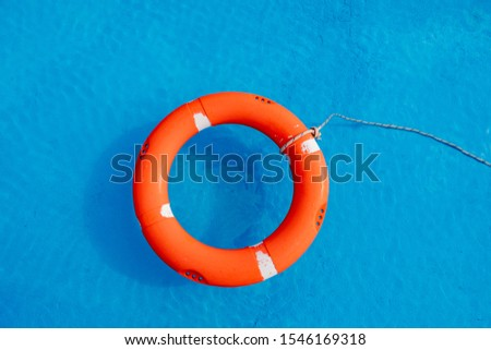 Colorful floats on a pool of crystal clear water #1546169318