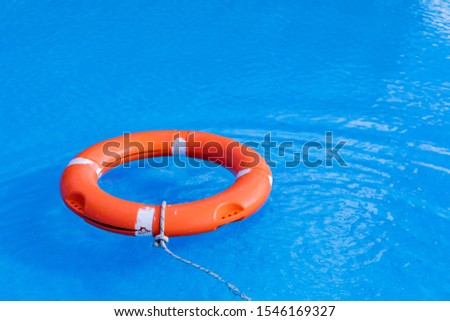 Colorful floats on a pool of crystal clear water #1546169327