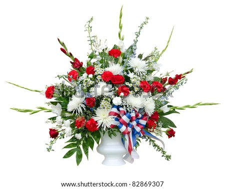 Colorful flower arrangement in urn isolated on white