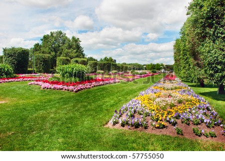 Colorful flower beds arranged by figures on the lawn