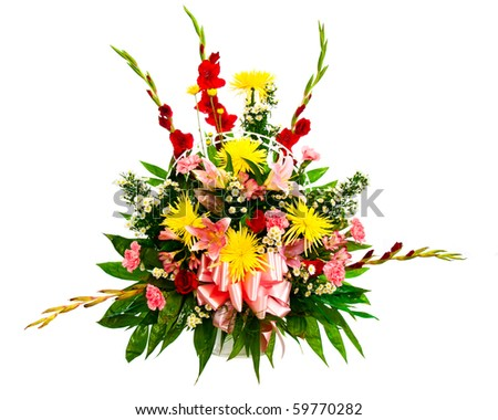 Colorful flower bouquet arrangement in basket isolated on white.