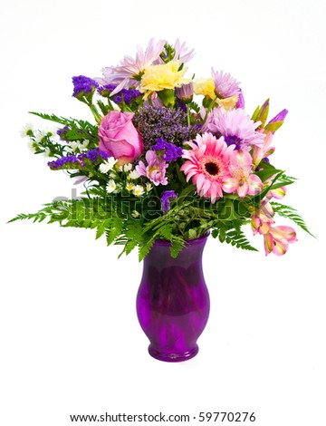 Colorful flower bouquet arrangement in vase isolated on white.