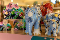Colorful flower elephants on display in shopping mall in Northern Thailand
