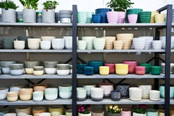 Colorful flower pots on the shelf in the store