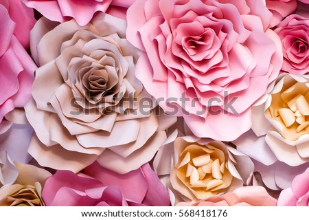 Colorful flowers paper background. Red, pink, purple, brown, yellow and peach handmade paper roses #568418176
