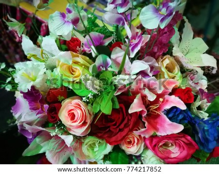 Colorful flowers red, green,yellow purple and pink  in basket .vintage style. #774217852