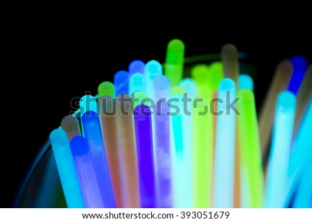 Colorful fluorescent light neon on black background #393051679