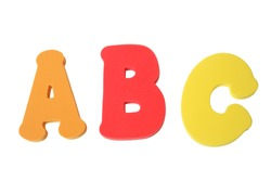 Colorful foam letters spelling ABC on white background