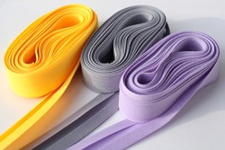 Colorful fold bias tape on white background. Coil with bias binding.Various colors.