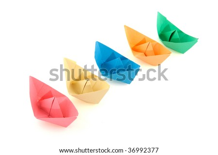 colorful folder paper boats isolated over white