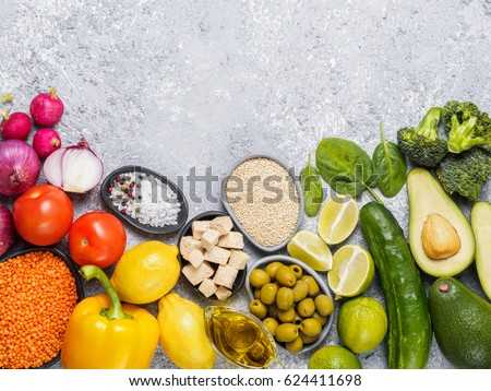 Colorful food background. Vegan food ingredients with copy space. Cereals and vegetables on gray concrete background. Healthy eating concept #624411698