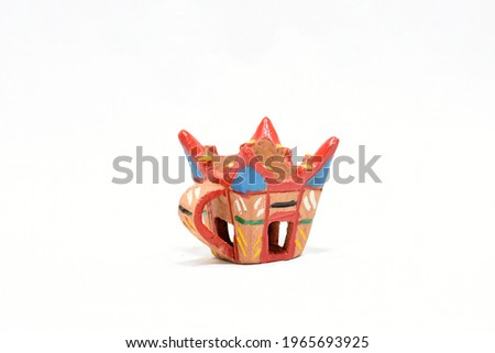 Colorful Frankincense Burner Pottery in Oman Style, on white background. It's one of the most popular souvenir from Oman. Simply use for Oman Travel Content or shopping concept